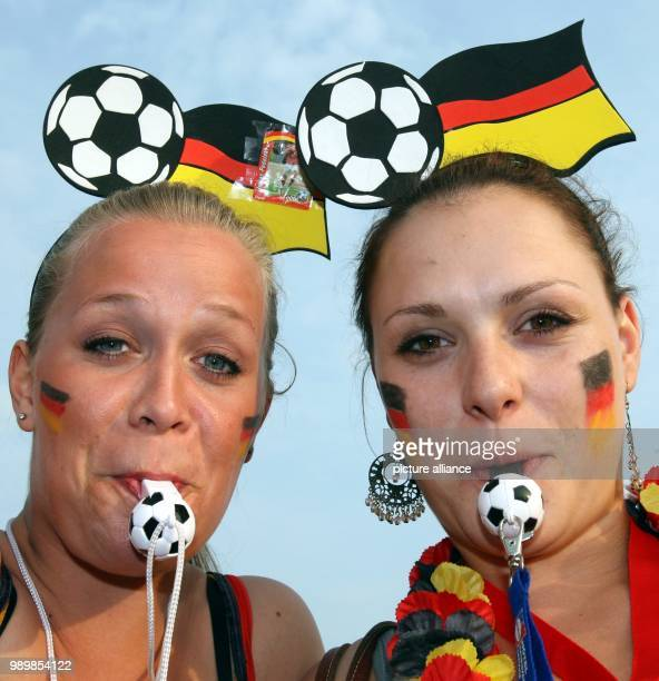 Supporters of Germany cheer prior to the FIFA World Cup 2006 Group A preliminary round match against Poland during the supporter festival in Hamburg...
