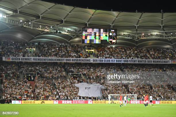 Supporters of Germany display a banner against violence during the FIFA 2018 World Cup Qualifier between Germany and Norway at MercedesBenz Arena on...