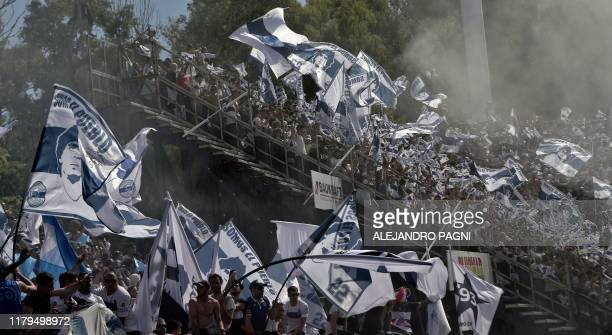 Supporters of Gimnasia y Esgrima cheer for their team during an Argentina First Division Superliga football match against Estudiantes, at El Bosque...