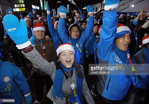 Supporters of Grand National Party presidential candidate Lee MyungBak celebrate outside the party headquarters building in Seoul 19 December 2007...