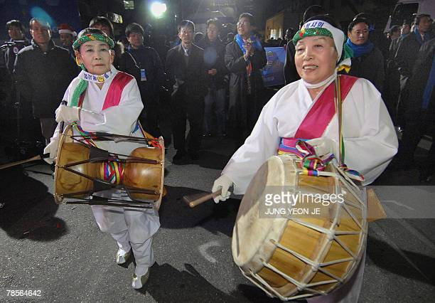 Supporters of Grand National Party presidential candidate Lee MyungBak dressed the traditional costume play music outside the party's headquarters in...