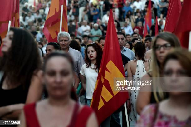 Supporters of Greece's Comunist Party KKE hold flags during a demonstration in Athens on July 2 2015 General Secretary of the KKE called his party's...