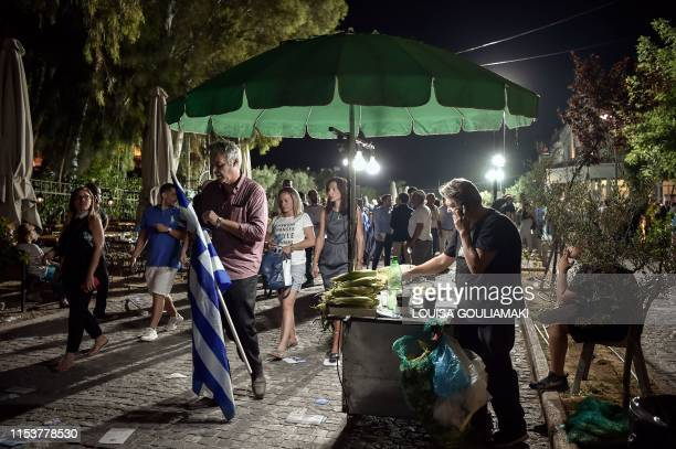 Supporters of Greece's opposition party New Democracy leave after its leader's speech during a preelection rally in Athens on July 4 three days ahead...