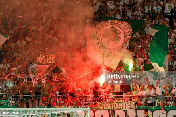 Supporters of Greuther Fuerth are seen during the DFB Cup first round match between Greuther Fuerth and Borussia Dortmund at Sportpark Ronhof Thomas...