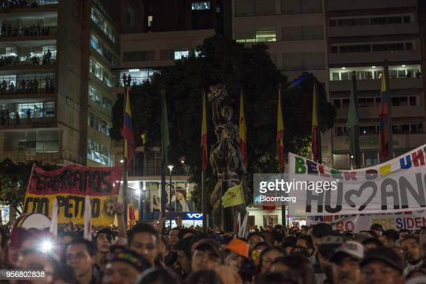 Supporters of Gustavo Petro presidential candidate for the Progressivists Movement Party hold up banners during a campaign rally in Pereira Colombia...