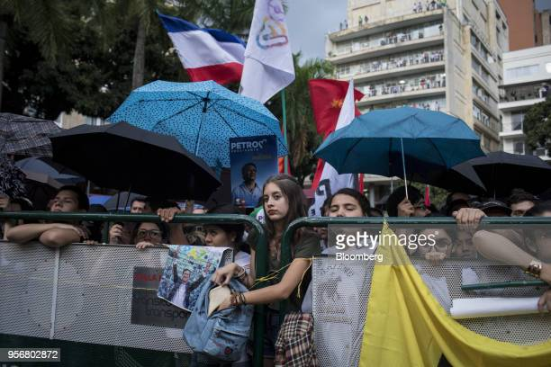 Supporters of Gustavo Petro presidential candidate for the Progressivists Movement Party shelter under umbrellas during a campaign rally in Pereira...