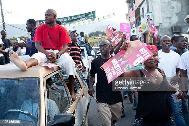 Supporters of Haitian presidential candidate Michel Martelly protest in the Delmas neighborhood on November 28 2010 in PortauPrince Haiti Following...