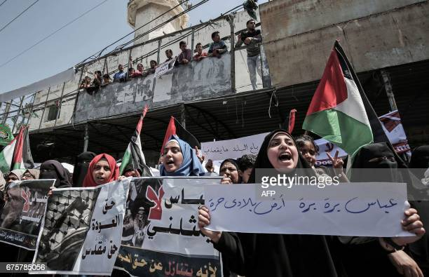 TOPSHOT Supporters of Hamas Islamic Jihad and AlAhrar movement protest against Palestinian Authority president Mahmud Abbas in the southern Gaza...