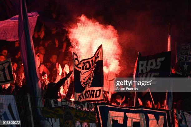 Supporters of Hamburg light flares during the Bundesliga match between SV Werder Bremen and Hamburger SV at Weserstadion on February 24 2018 in...