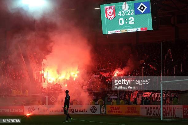 Supporters of Hamburg use pyrotechnical articles during the DFB Cup second round match between Hallescher FC and Hamburger SV at ErdgasSportpark on...