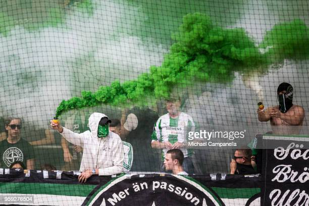Supporters of Hammarby IF light flares and smoke bombs during an Allsvenskan match between Hammarby IF and Malmo FF at Tele2 Arena on May 16 2018 in...