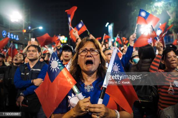 Supporters of Han Kuo-Yu, presidential candidate for Taiwan's main opposition Kuomintang party, react during a rally outside the campaign...