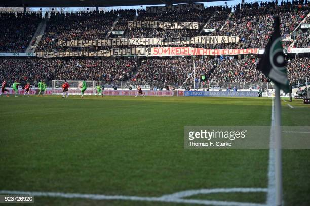 Supporters of Hannover show protest banners during the Bundesliga match between Hannover 96 and Borussia Moenchengladbach at HDIArena on February 24...