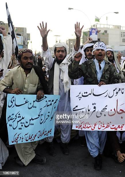 Supporters of hardline pro-Taliban party Jamiat Ulema-i-Islam-Nazaryati chant slogans in support of arrested Pakistani bodyguard Malik Mumtaz Hussain...