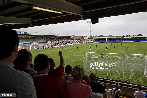 Supporters of Hartlepool United watching the firsthalf action at the Victoria Ground Hartlepool during a preseason friendly between the home team and...