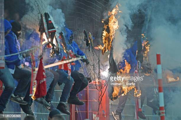 Supporters of Hertha burn clothes of Union supporters during the Bundesliga match between 1. FC Union Berlin and Hertha BSC at Stadion An der Alten...