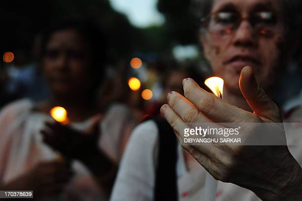 Supporters of Hindu yoga guru Baba Ramdev participate in a candle light rally following the recent gangrape and murder of a 20yearold college student...