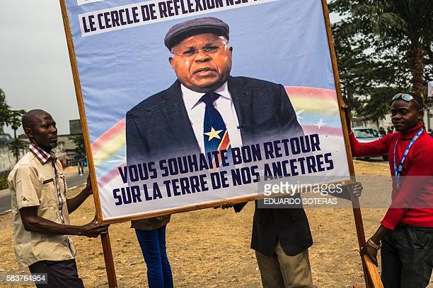 Supporters of historical opponent Etienne Tsisekedi transport a sign with his portrait in front of his residence in Kinshasa on July 27 2016 as...
