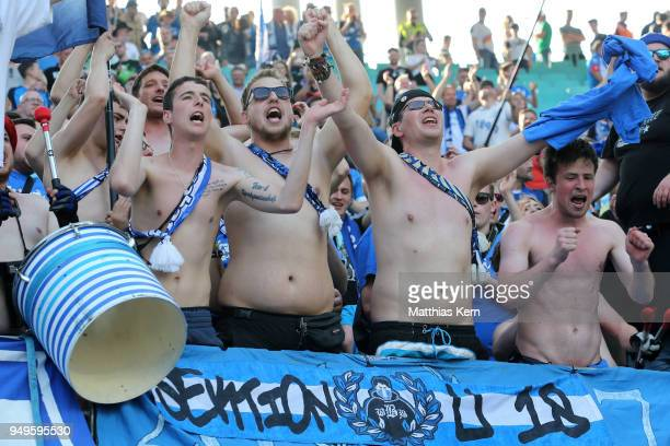 Supporters of Hoffenheim celebrate their team during the Bundesliga match between RB Leipzig and TSG 1899 Hoffenheim at Red Bull Arena on April 21...