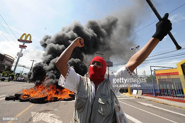 Supporters of Honduran President Manuel Zelaya protest against the coup d'etat in the surroundings of the presidential house in Tegucigalpa June 28...