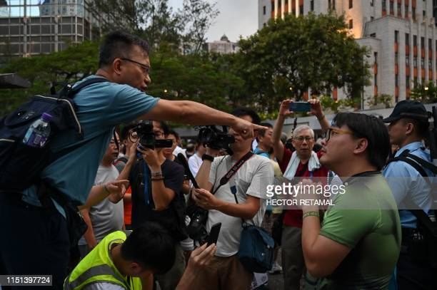 TOPSHOT Supporters of Hong Kong a police argue with people from democratic sectors during a rally to support to the local police force in Honk Kong...
