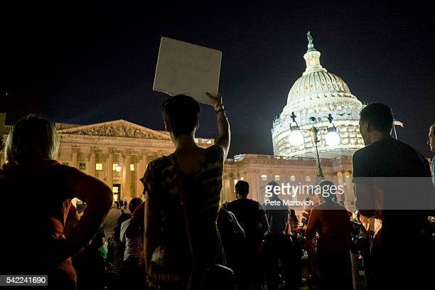 Supporters of House Democrats taking part in a sitin on the House Chamber shout encouragement from outside the US Capitol on June 22 2016 in...