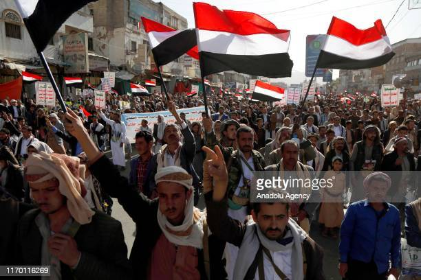 Supporters of Houthis participate in march on the occasion of the fifth anniversary of Houthis' control of the Yemeni capital Sanaa, on September 21,...