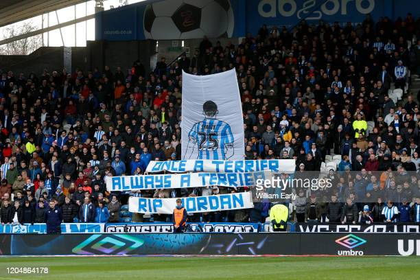 Supporters of Huddersfield Town show their respect for Jordan Sinnott during the Sky Bet Championship match between Huddersfield Town and Queens Park...