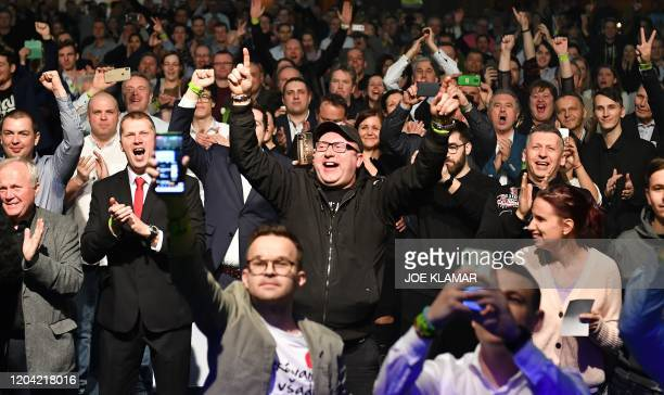 Supporters of Igor Matovic leader of the antigraft political movement Ordinary People and Independent Personalities cheer during the party's...