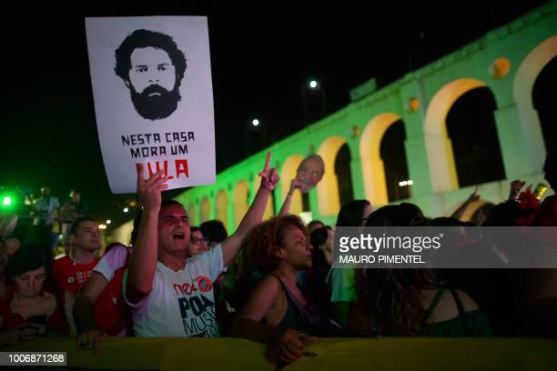 Supporters of imprisoned former Brazilian President Luiz Inacio Lula da Silva with a sign reading 'In this house lives Lula' attend the 'Lula Livre'...