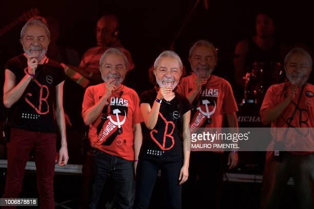 Supporters of imprisoned former Brazilian President Luiz Inacio Lula da Silva wear masks depicting him during the 'Lula Livre' Music Festival in Rio...
