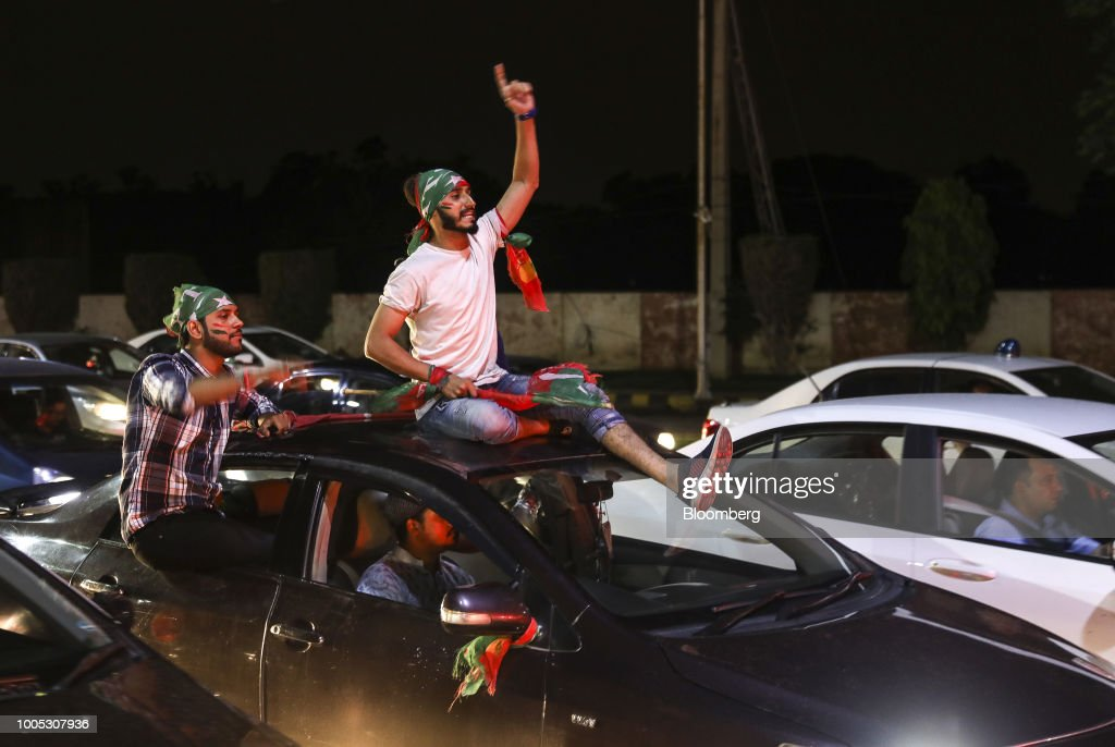 Supporters of Imran Khan head of the Pakistan TehreekeInsaf also known as Movement for Justice celebrate on a street in Lahore Pakistan on Wednesday..