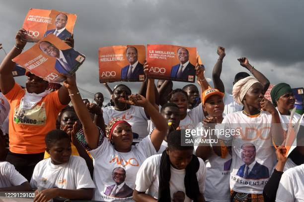 Supporters of incumbent president Alassane Ouattara take part in a campaign meeting ahead of the presidential election, on October 17, 2020 in...