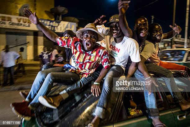 TOPSHOT Supporters of Incumbent President Denis Sassou Nguessu celebrate in the streets of Brazzaville after informations of an early lead in the...