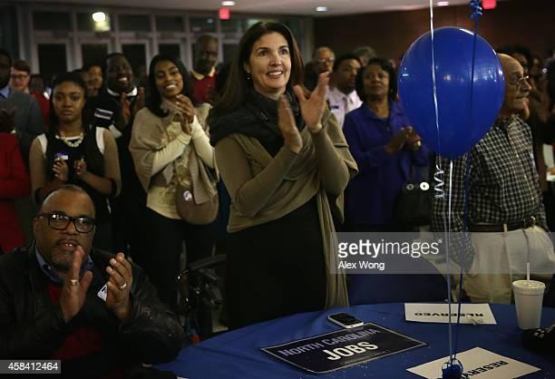 Supporters of incumbent US Sen Kay Hagan react during Hagan's election night party November 4 2014 in Greensboro North Carolina Sen Kay Hagan is...