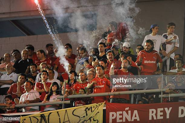 Supporters of Independiente cheer their team during a second final match against Goias as part of the 2010 Copa Nissan Sudamericana at Libertadores...