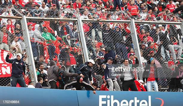 Supporters of Independiente react after a match between River Plate and Independiente as part of the Torneo Final 2013 at the Monumental Vespusio...