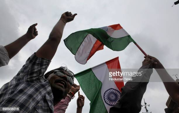 Supporters of Indian activist Anna Hazare march during a rally in support of Hazare at Bandra in Mumbai India Sunday
