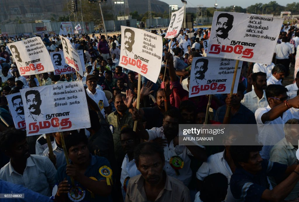 Supporters of Indian cinema actor Kamal Hassan hold placards his portraits during the launch of his new political party 'Makkal Needhi Mayyam' in Madurai on February 21, 2018. / AFP PHOTO / Arun SANKAR