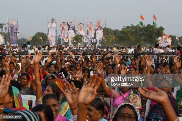 Supporters of Indian Congress party gesture during a public meeting for the campaign of the 2018 Telangana state Assembly elections at Medchal...
