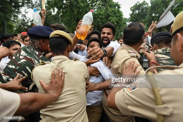 Supporters of Indian National Congress protest against rising prices of fuel in India in front of Ministry of Petroleum and Natural Gas office.