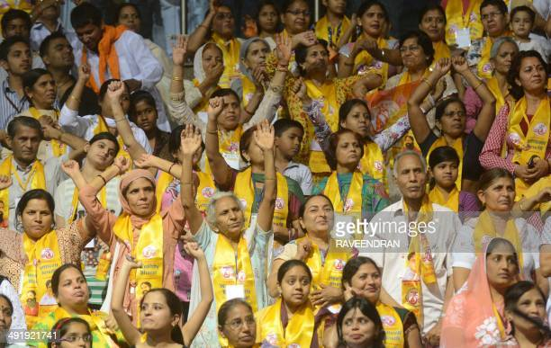 Supporters of Indian yoga guru Baba Ramdev attend a Pledge Completion rally following the Bharatiya Janata Party's win in the national elections in...