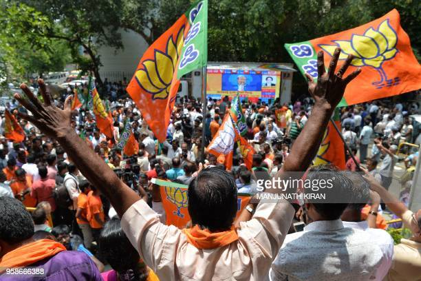 Supporters of India's Bhartiya Janata Party celebrate election results in front of the BJP state party office in Bangalore on May 15 2018