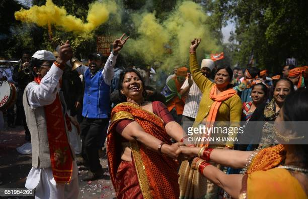 TOPSHOT Supporters of India's Bhartiya Janata Party celebrate elections results outside the party headquarters in New Delhi on March 11 2017 India's...
