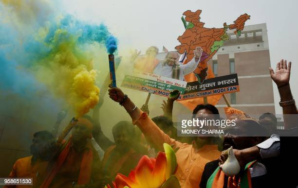 Supporters of India's Bhartiya Janata Party celebrate the election results outside the party headquarters in New Delhi on May 15 2018
