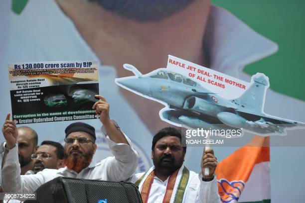 Supporters of India's Congress party display placards during a protest against the Rafale jets deal in Hyderabad on August 1 2018 The Rafale deal has...