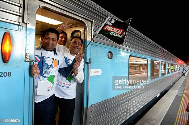 Supporters of India's Prime Minister Narendra Modi prepare to ride an overnight train with some 200 others from Southern Cross station in Melbourne...