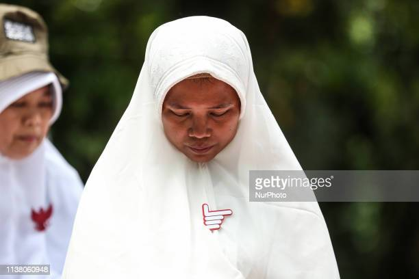 Supporters of Indonesian presidential candidate Prabowo Subianto pray after this week's presidential election in Jakarta Indonesia on April 19 2019...