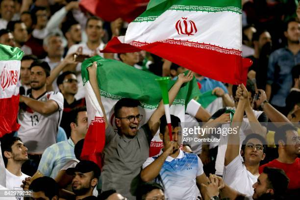 Supporters of Iran cheer for their team during the FIFA World Cup 2018 qualification football between Syria and Iran at the Azadi Stadium in Tehran...