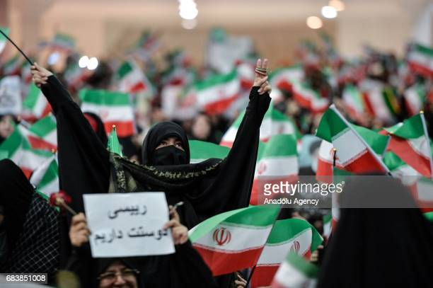 Supporters of Iranian cleric and presidential candidate Ebrahim Raisi wave flags during a rally prior to presidential elections in Tehran, Iran on...